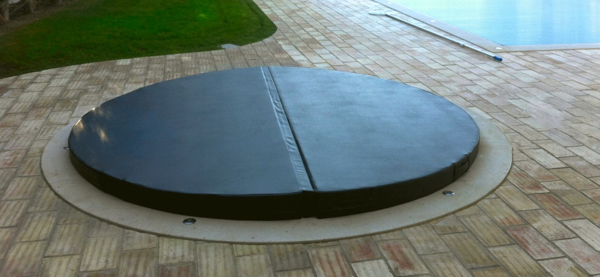 Image of a Hot tub cover in a garden near a pool